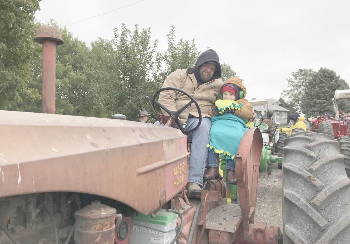 Man and child on tractor
