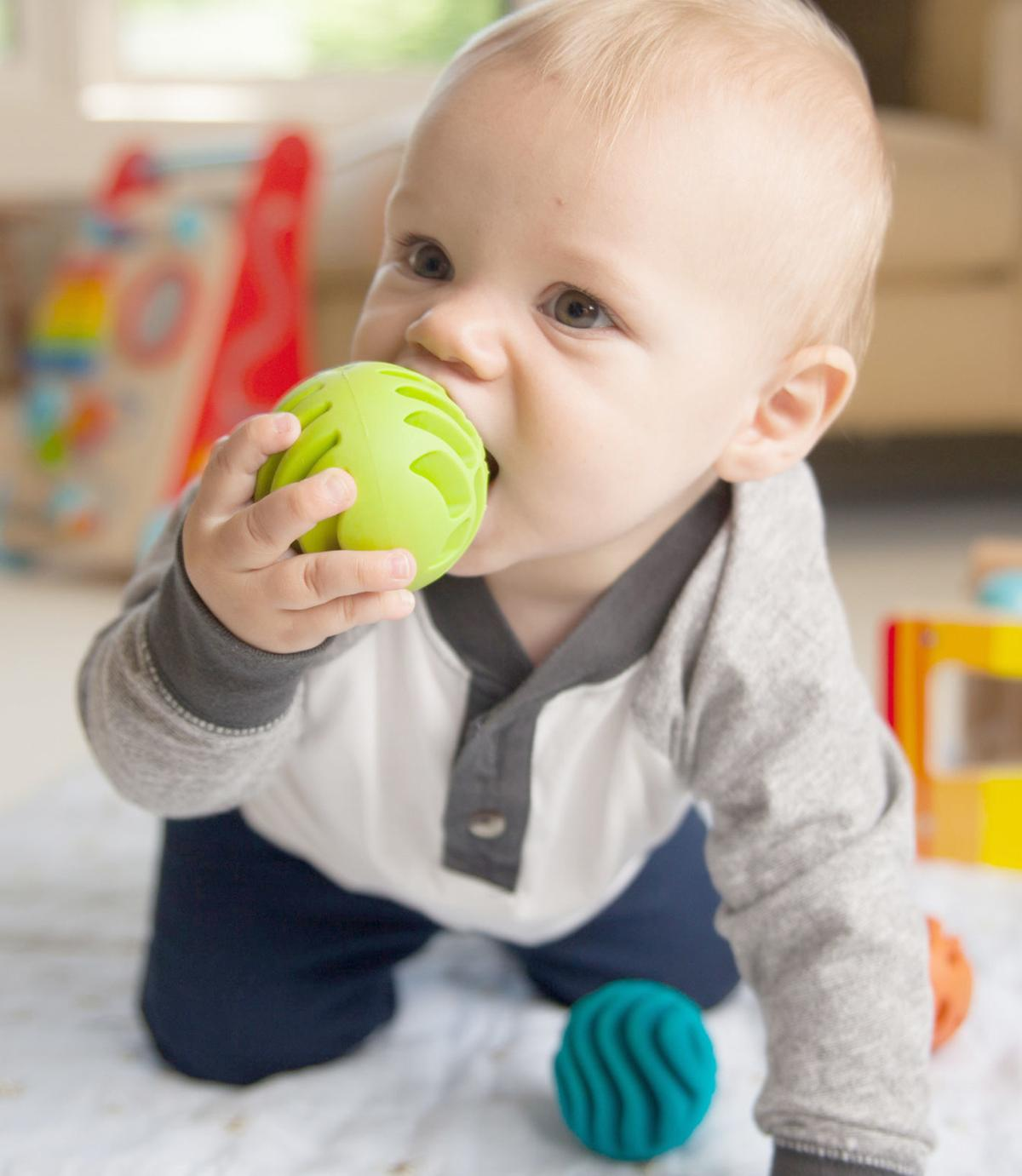 Crawling baby with ball