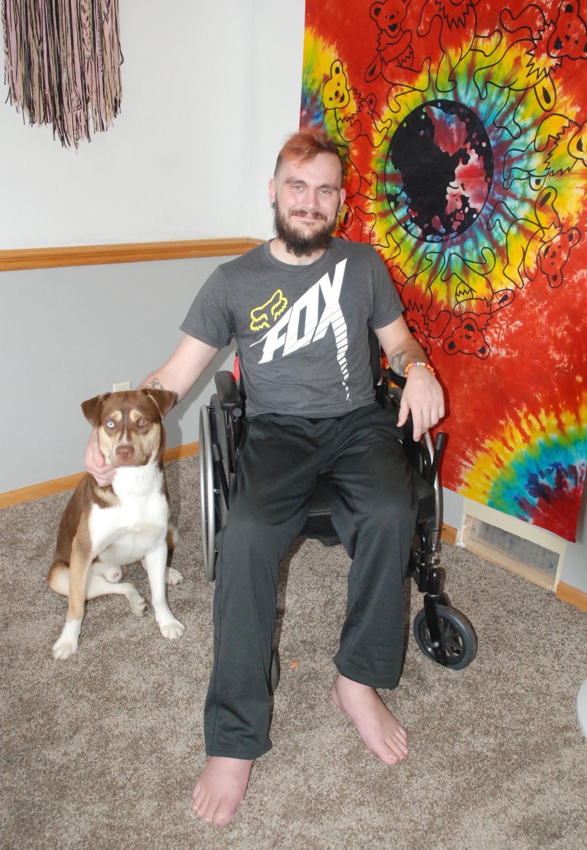 Man in chair near dog
