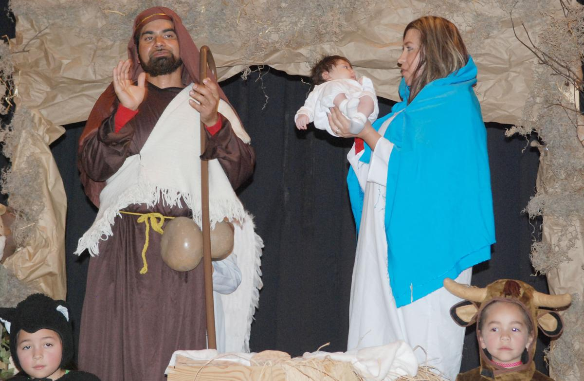 Posada finale Joseph clapping and Mary holding up Jesus