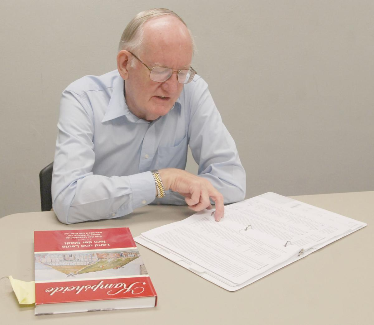 Man looking over genealogy book