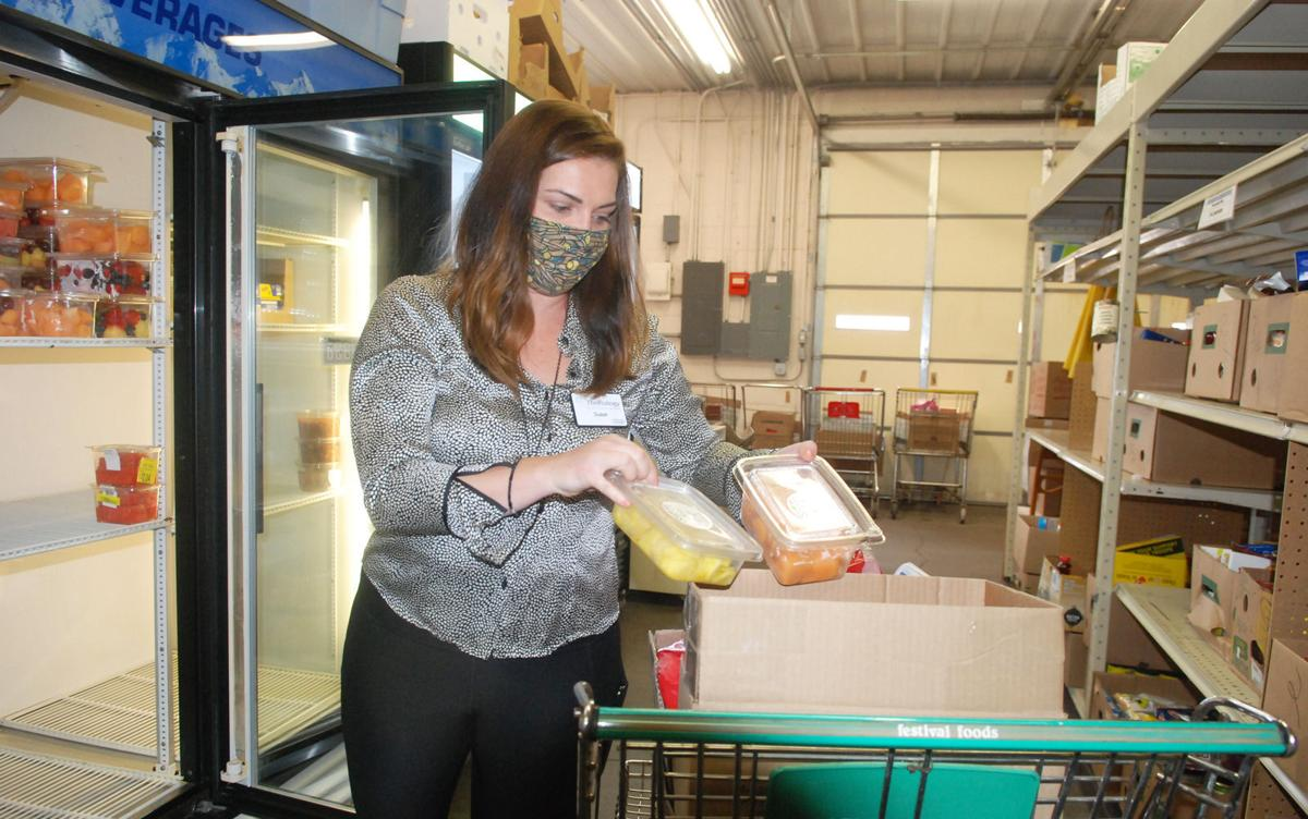 FRE Woman loading fruit into boxes.jpg