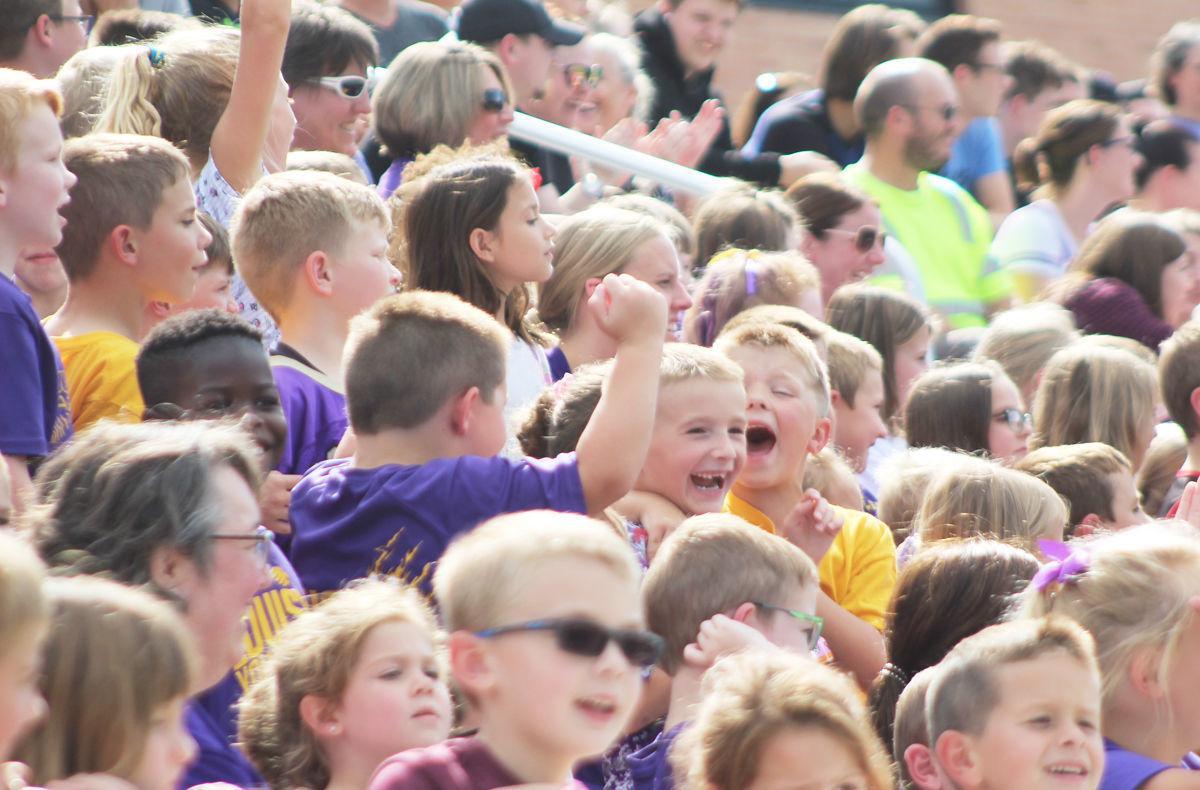 Kids cheering at pep rally