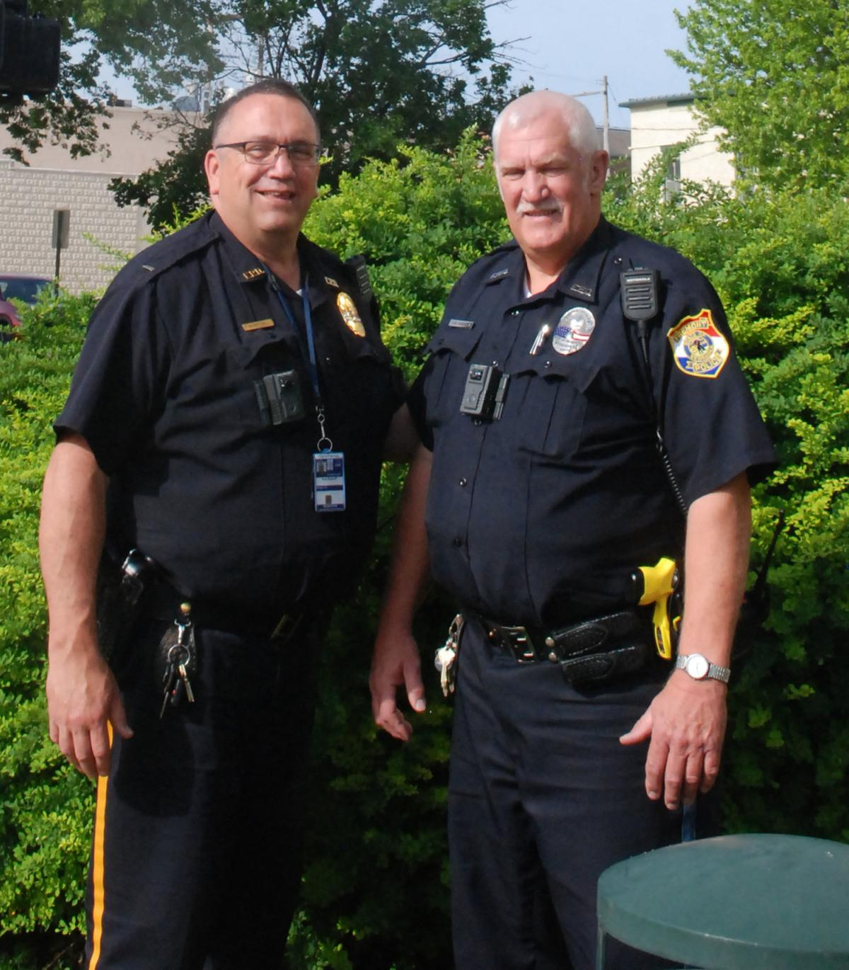 Lt and Officer Hanson near greenery
