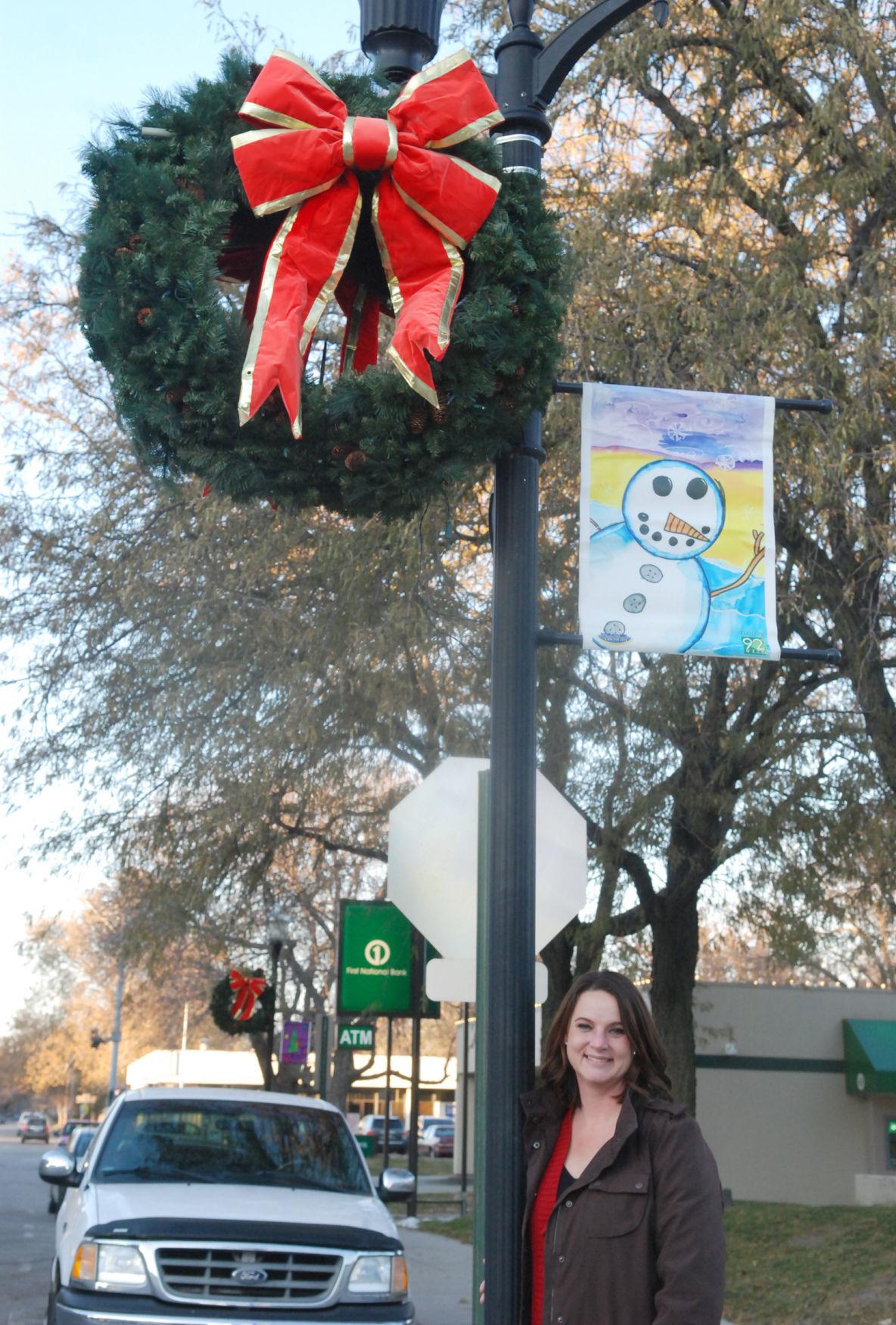 Woman by wreath on pole