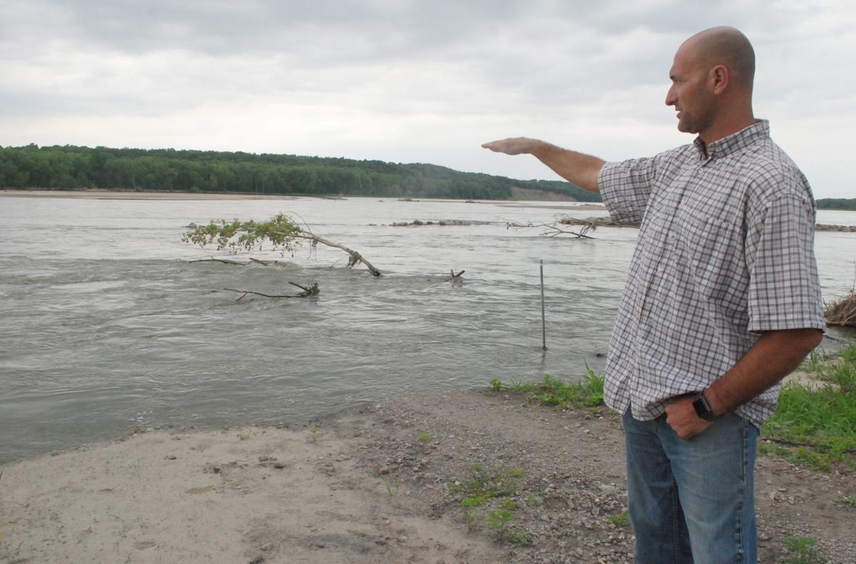 Man pointing at river