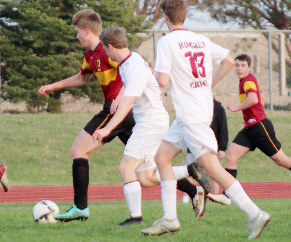 Alex Lamoureux moves soccer ball upfield