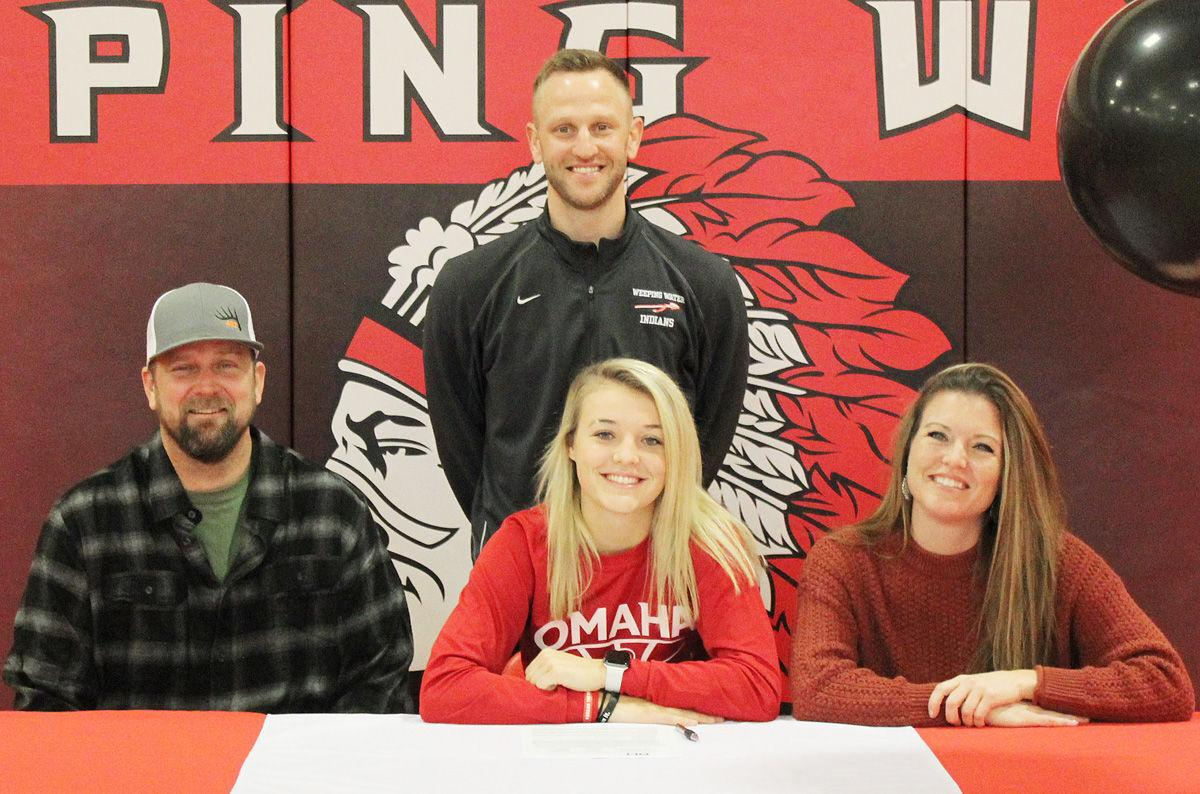 Parents and coach at Grace Cave signing ceremony
