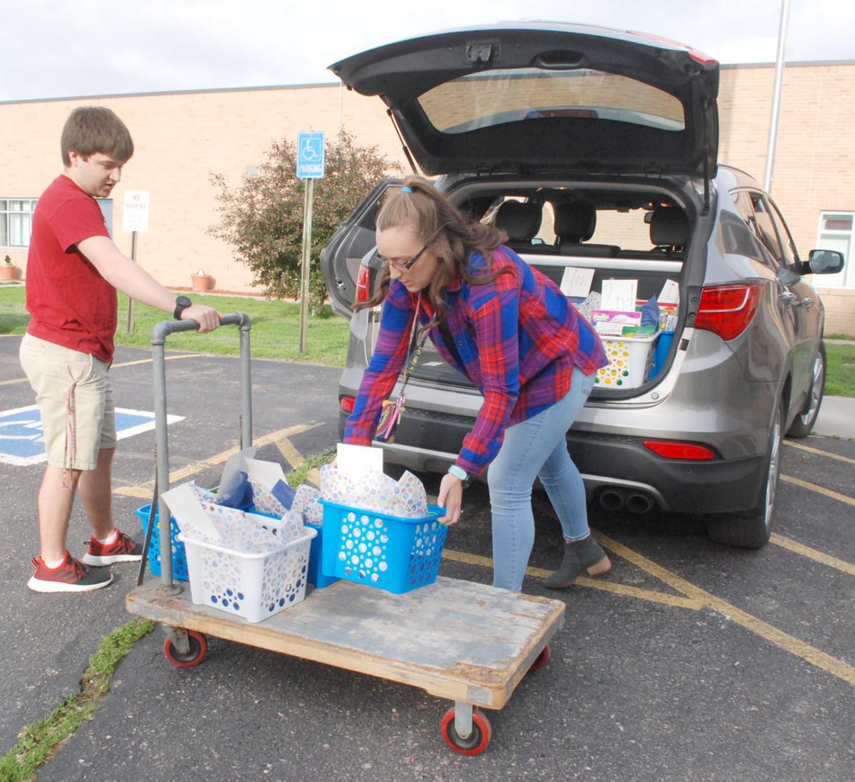 Brooke and Nathan unloading supplies