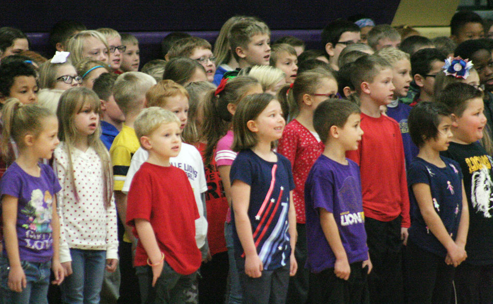 Elementary students sing at Louisville assembly