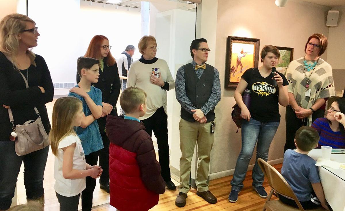 FRE Teacher talks at art reception.jpg