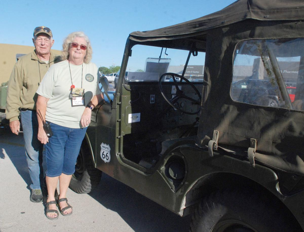 Florida couple in front of historic military vehicle