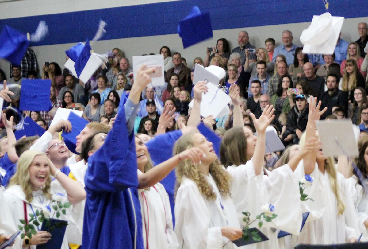 Plattsmouth students throwing mortarboards