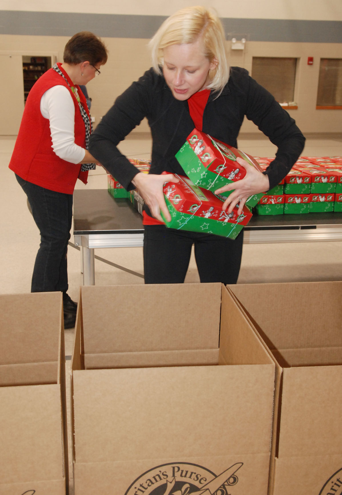 Operation Christmas Child Boxes.Residents Filling Shoeboxes With Gifts For Operation