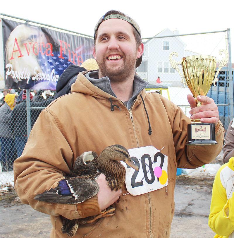 Ryan Leonardo smiles with trophy