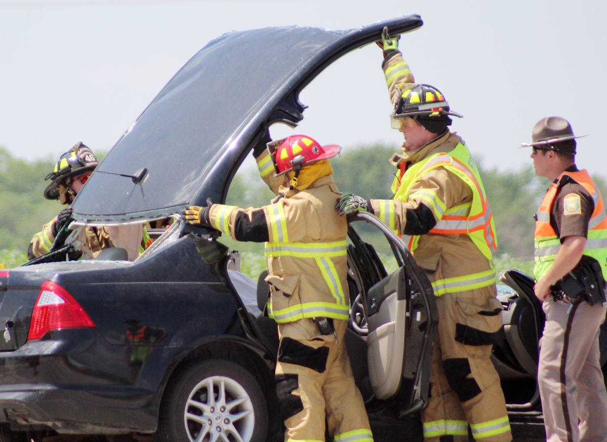 Prying roof off vehicle after accident