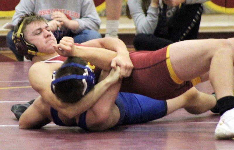 Justin Pick pins opponent for Conestoga