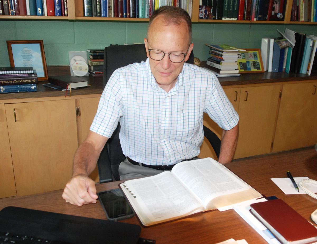 Pastor at desk