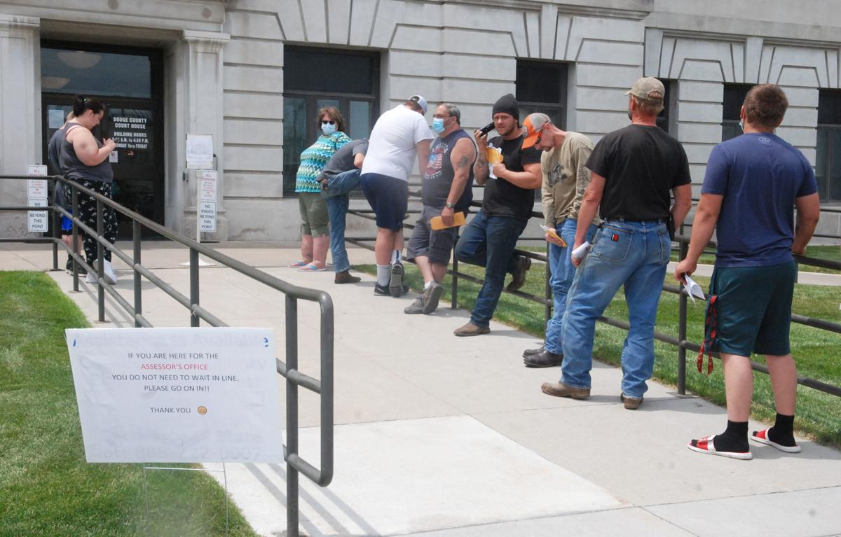 FRE People standing outside courthouse.jpg