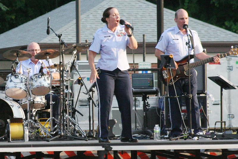 Jarett Robinett Rebecca Packard Anthony Schmaus on stage