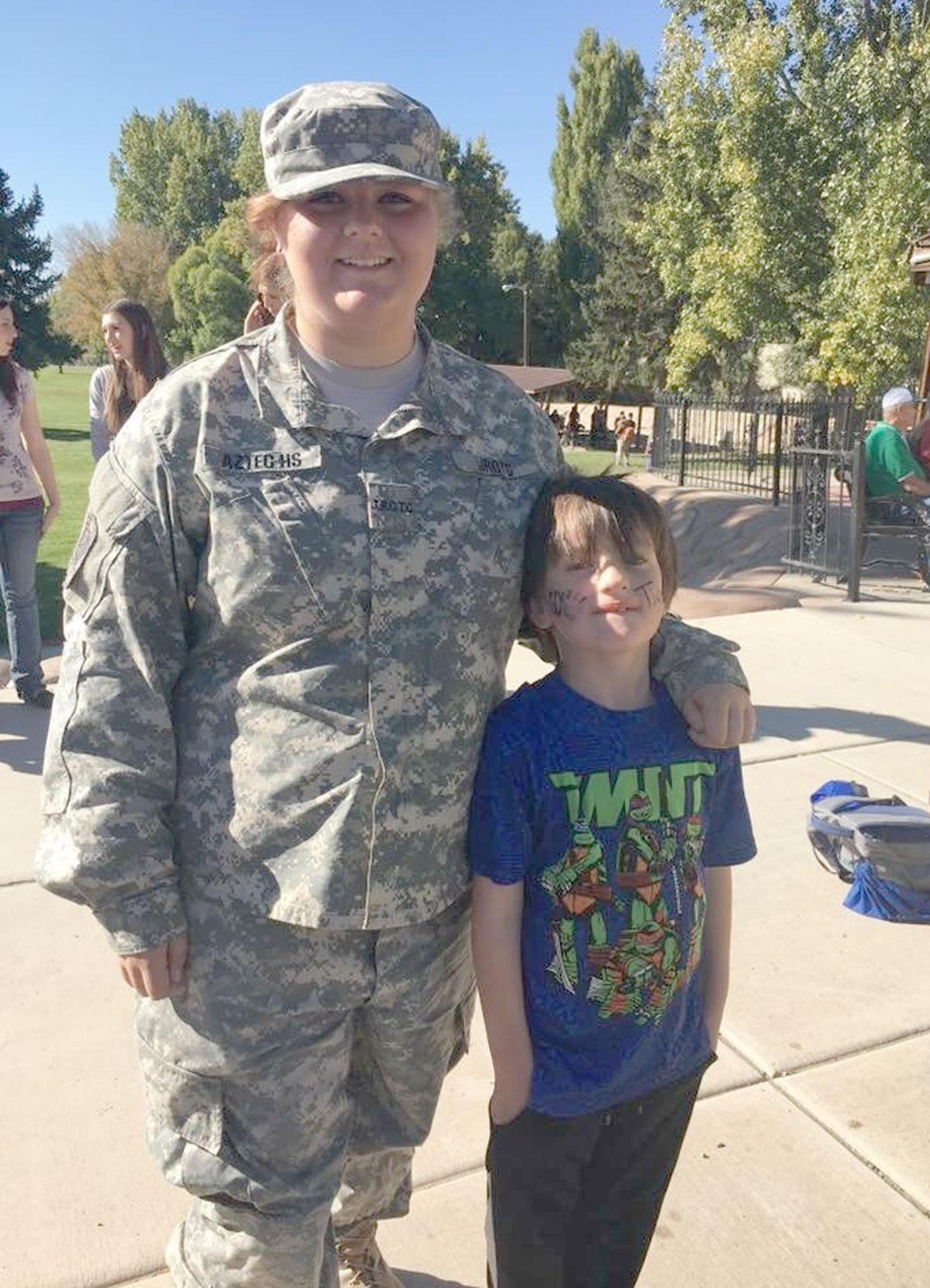 School shooting survivor in uniform with little brother