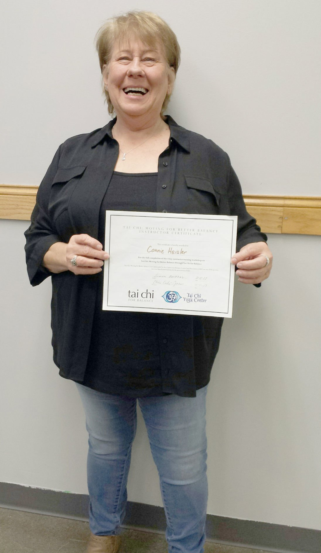 Connie standing with certificate