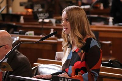 Omaha Sen. Megan Hunt speaks Tuesday on LB209.