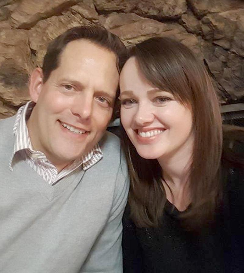 The Rev. Aaron and Sara Trimble by fireplace