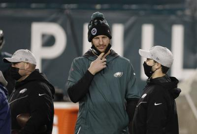 Philadelphia Eagles quarterback Carson Wentz lowers his face mask before the team's game Sunday night against the Washington Football Team on Jan. 3, 2021.