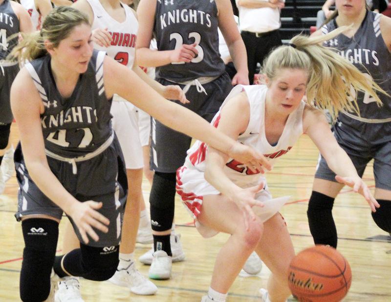 Nicole Wenzel and Peyton Barrett battle for basketball