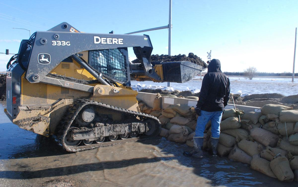 Piling dirt to help stop flood waters