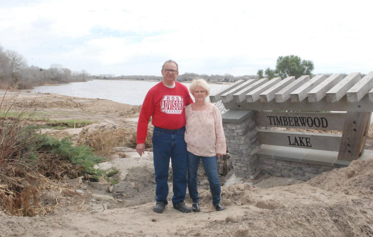 Timberwood Lake couple near sign