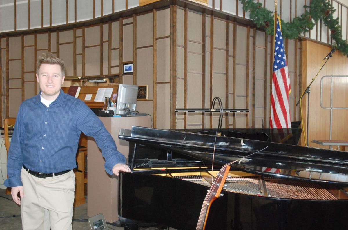 New pastor at Good Shepherd by piano