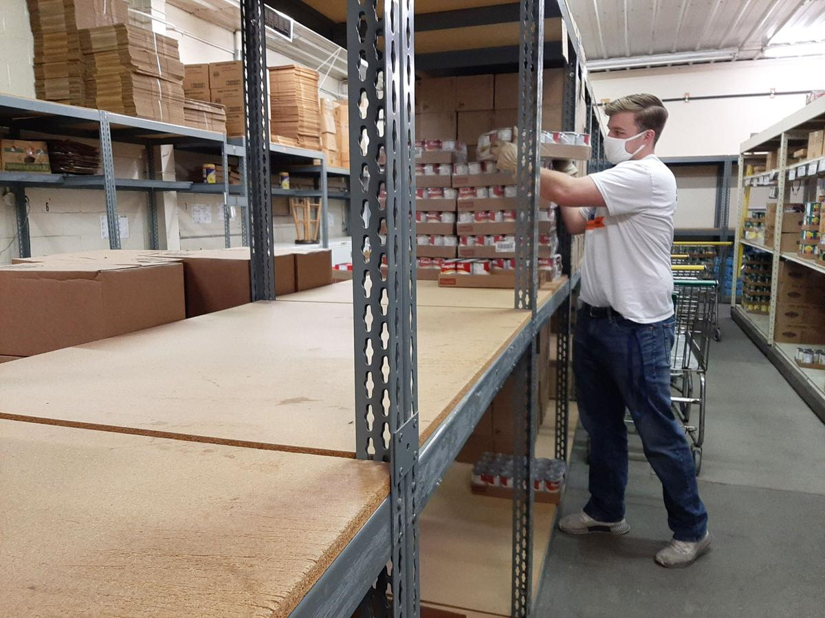 Young man stocking shelves