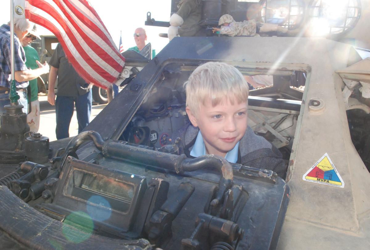 Boy inside British armored vehicle