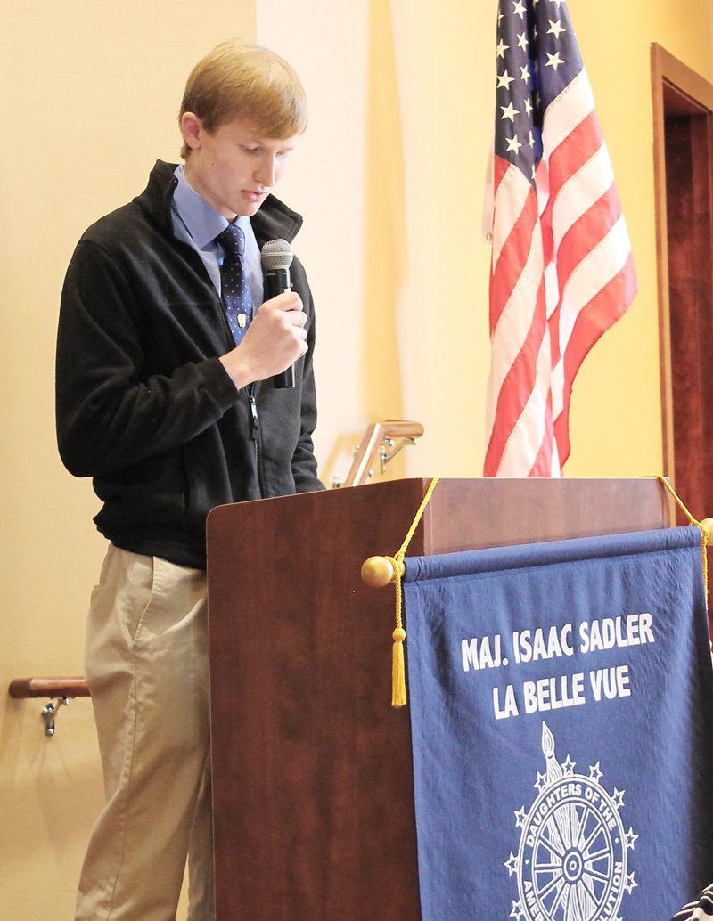 Garrett Quinn reading essay at DAR event