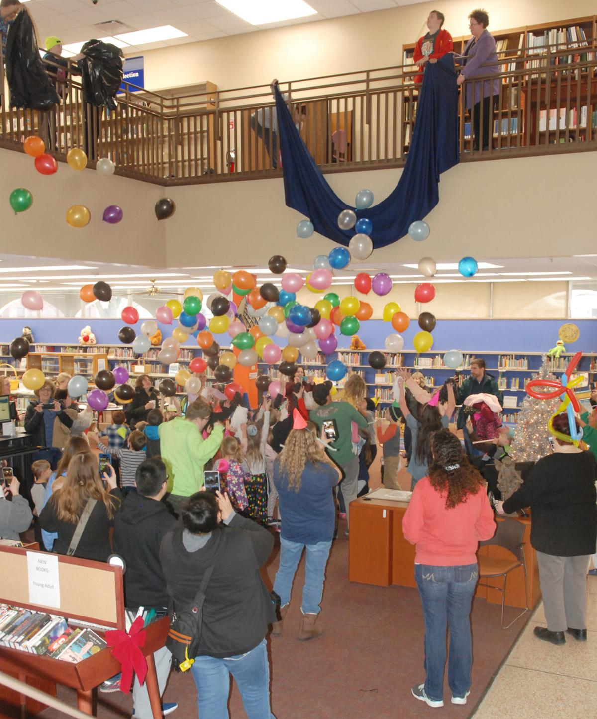 Library balloon drop at Noon Year's Eve