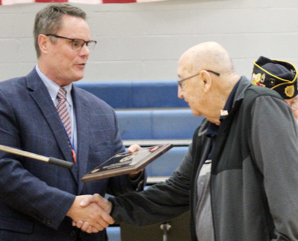 Todd Halvorsen presents Cecil McKnight with award