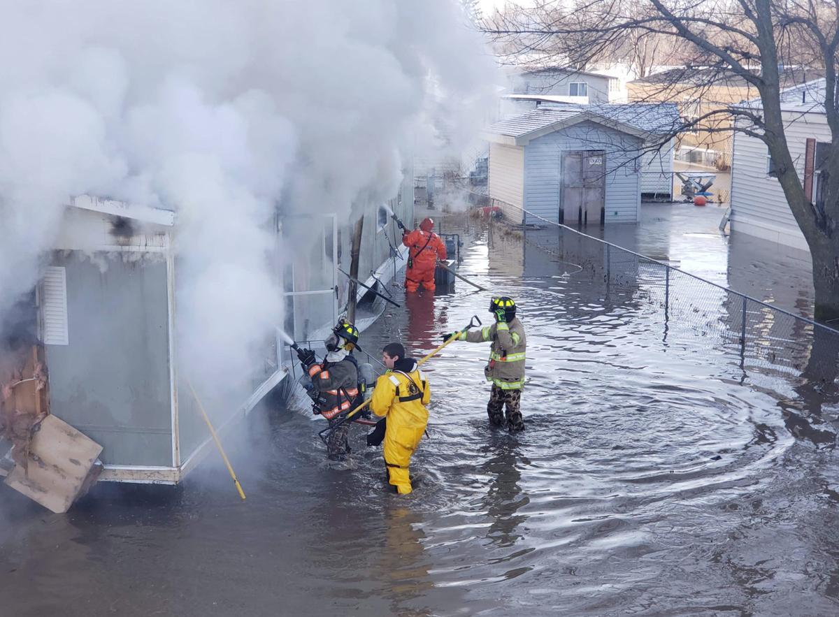 Firefighters in water