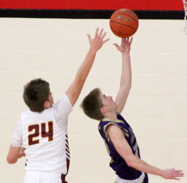 Doug Euans makes basket vs Kobe Gansemer