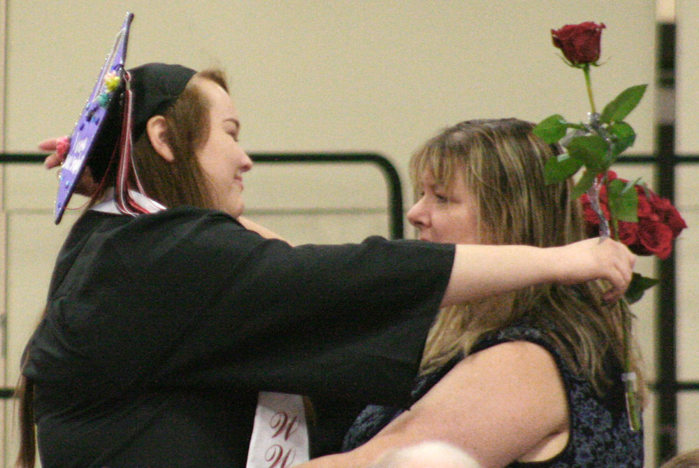 Becca Markham delivers hug at graduation