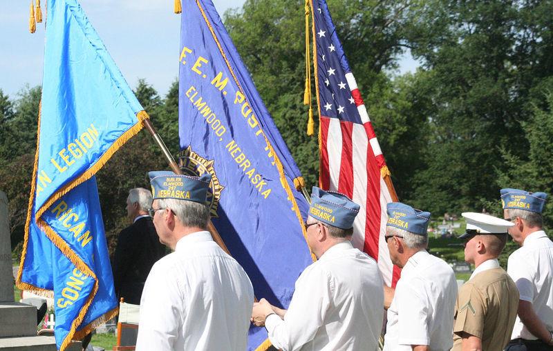 Displaying flags at Elmwood Memorial Day service