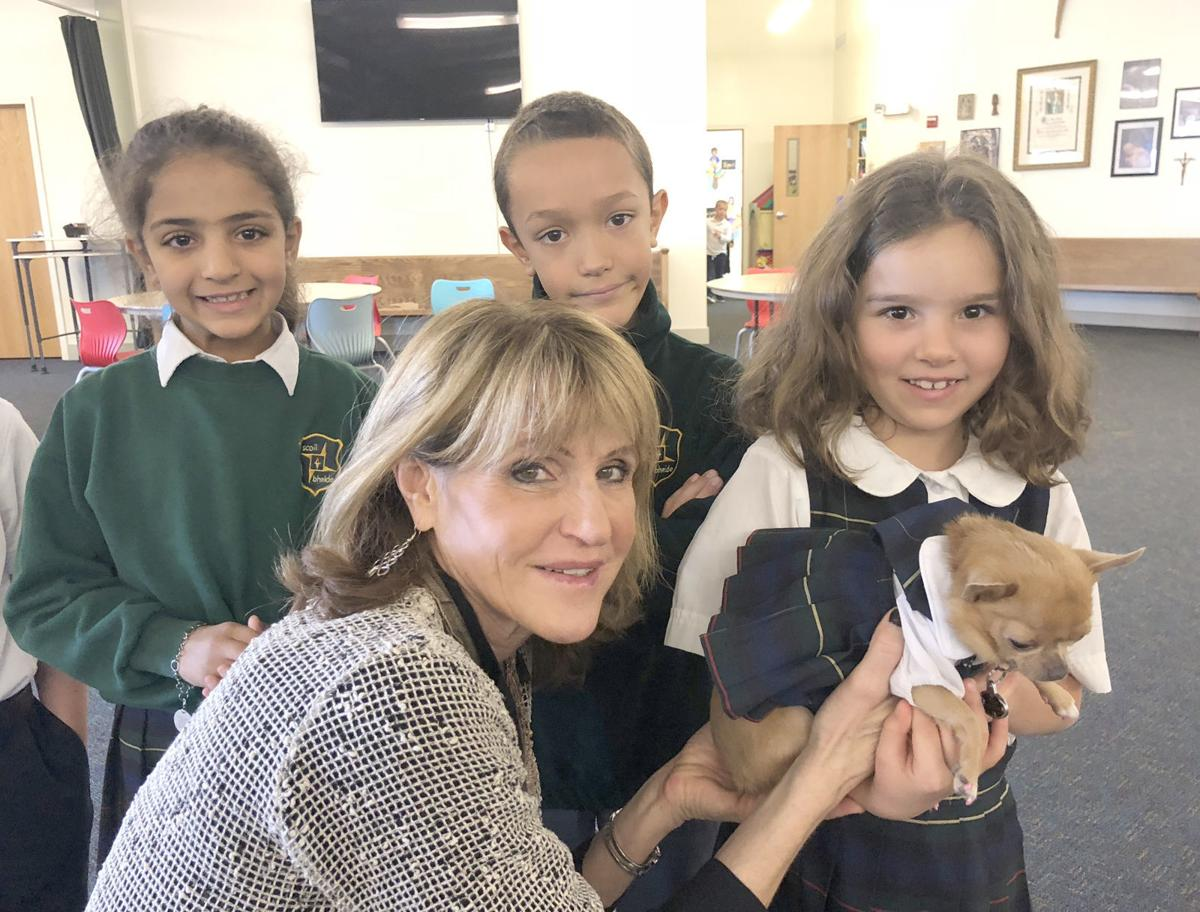 Author Julia Cook with children and dog