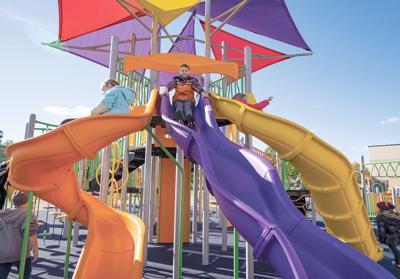 Kids on colorful slides