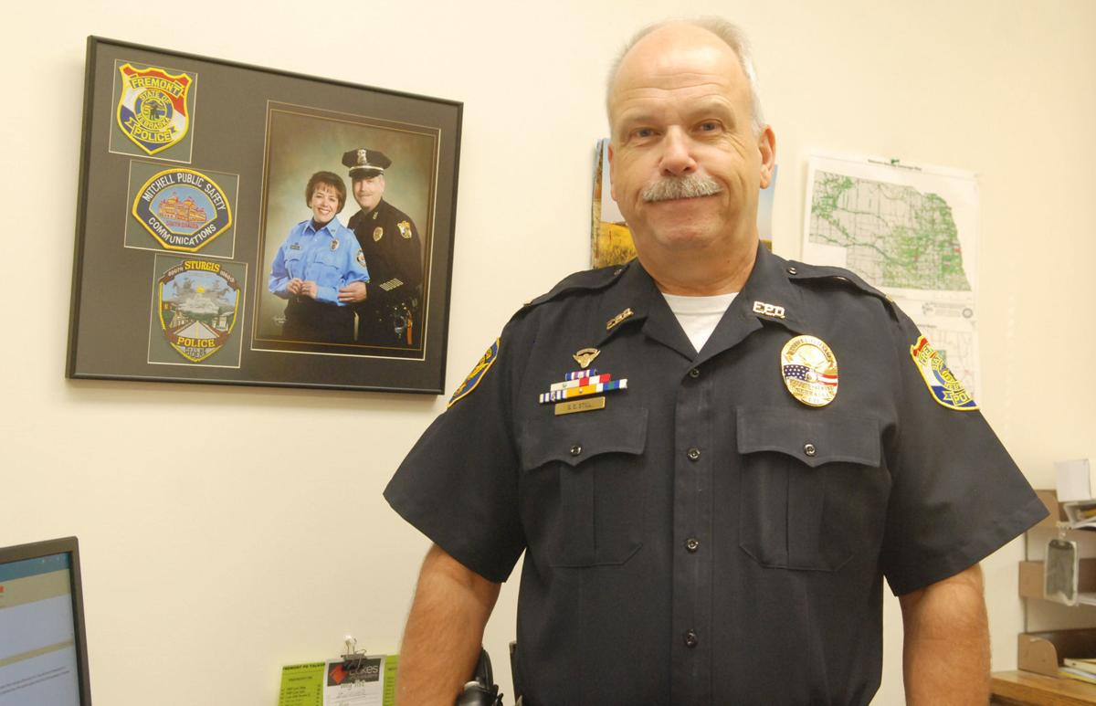 Officer standing near photo of wife