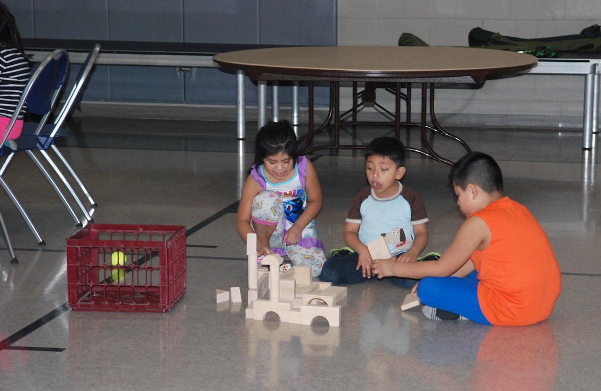 Evacuated children playing on floor