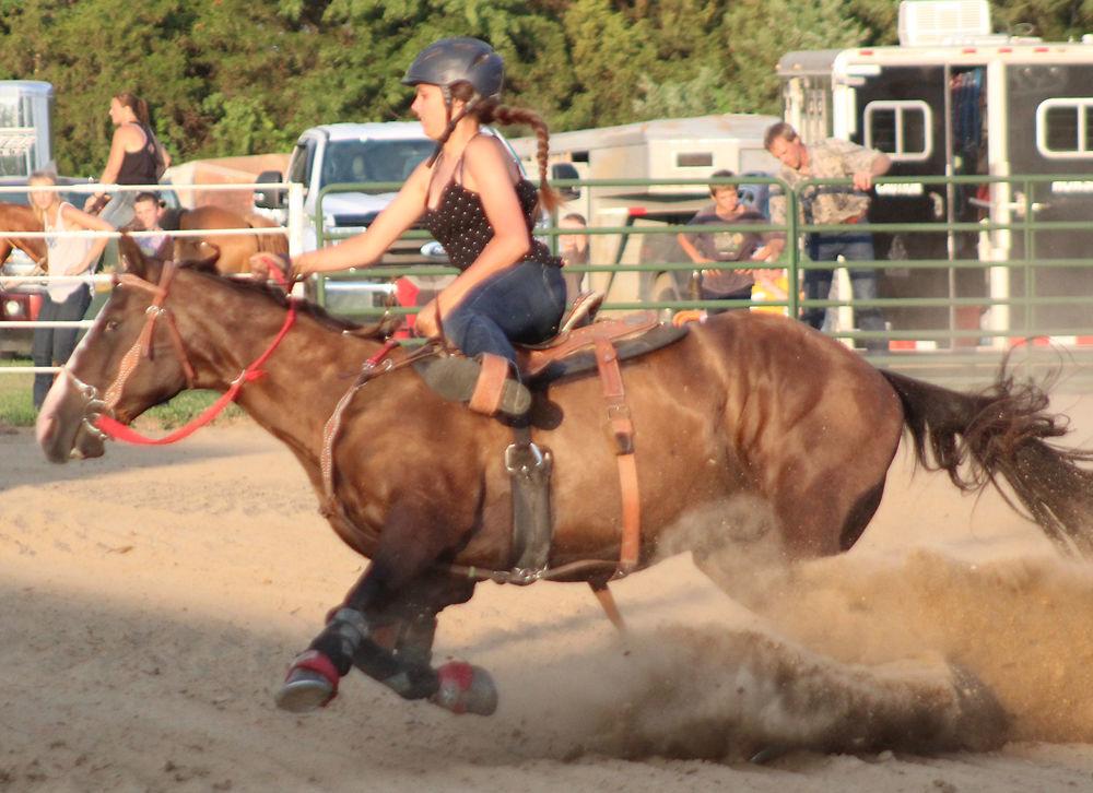 Sierra McMains rides in barrel horse race