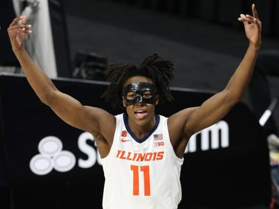 Illinois guard Ayo Dosunmu reacts after scoring a layup and taking a foul from a Rutgers player in the first half of a quarterfinal in the Big Ten Tournament on Friday at Lucas Oil Stadium in Indianapolis.