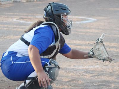 Hailey Montes catching for Plattsmouth