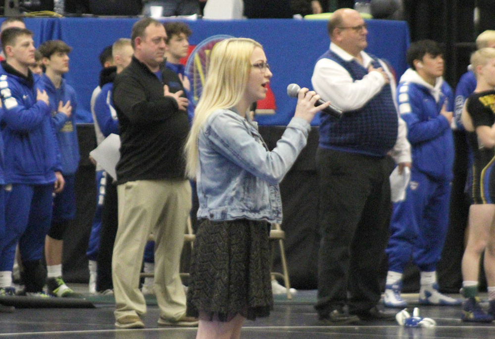 Gracey Simms sings national anthem at state duals